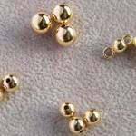 Goldkugeln hohl zwei Loch in 750, 585 Gelbgold.